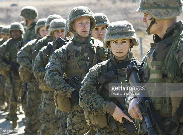 MARINES by Daphne Benoit US Marine Corps Officers at The Basic School practice on the shooting range February 25 at the USMC base in Quantico...