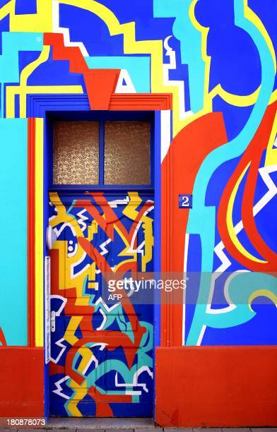 STORY by DEBORAH COLE A colorfully painted building on OttoRichterStrasse which was designed by architect Carl Krayl in 1920 and 1921 is pictured on...