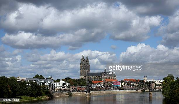 STORY by DEBORAH COLE A general overview shows the river Elbe and the landmark Cathedral of Saints Catherine and Maurice in Magdeburg eastern Germany...