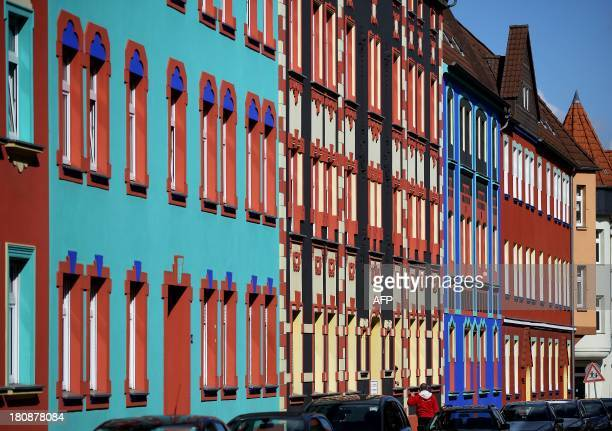 STORY by DEBORAH COLE Colorfully painted buildings on OttoRichterStrasse which were designed by architect Carl Krayl in 1920 and 1921 are pictured on...