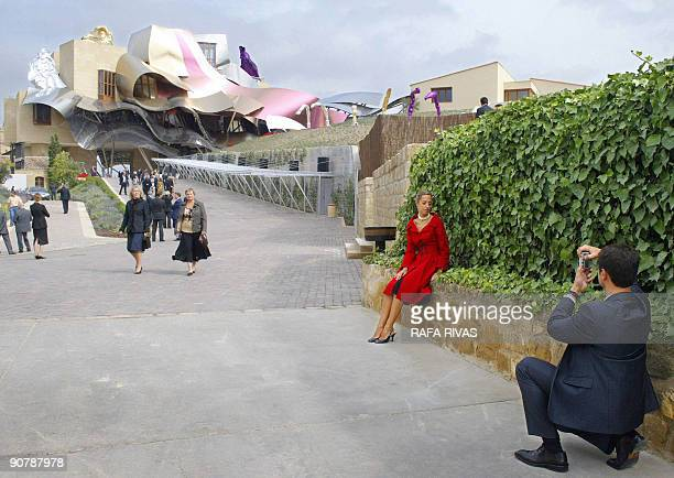 """By Denholm Barnetson """"Spain-economy-finance-tourism"""" This file picture dated October 10, 2006 shows couple taking photographs during the inauguration..."""