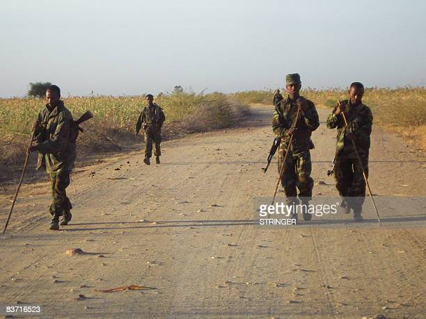 STORY by Emmanuel Goujon Ethiopian soldiers check for landmines on a road leading to the eastern Ethiopian border town of Badme on November 5 2008...