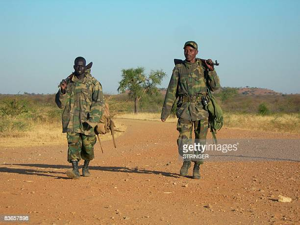 STORY by Emmanuel Goujon Two Ethiopian soldiers walk on a road leading to the eastern Ethiopian border town of Badme on November 5 2008 Tensions...
