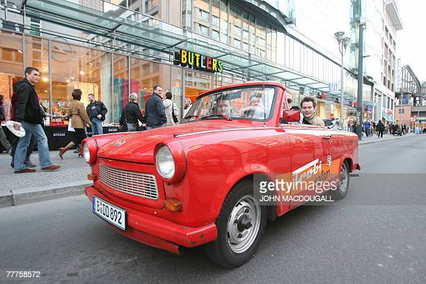 STORY by EMSIE FERREIRA FILES German youths enjoy a ride in a convertible Trabant through the streets of Berlin 24 April 2007 50 years ago on 07...