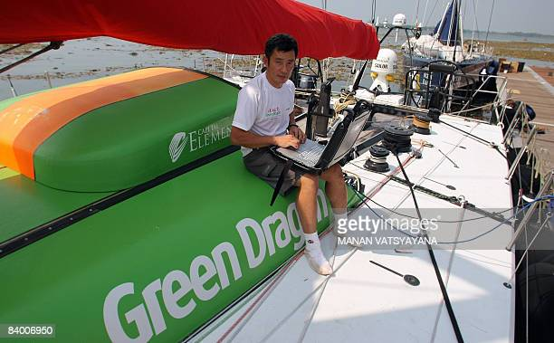 STORY 'YACHTINGINDIARACEVOLVO' by Eric Bernaudeau Media crew member of the yacht Green Dragon Guo Chuan poses on the deck of the Green Dragon in...