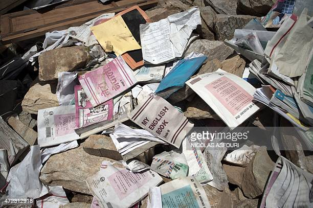 AID by Etienne LamySmith This photograph taken on May 4 shows books amid rubble of a school in the destroyed village of Mandre in north central Nepal...