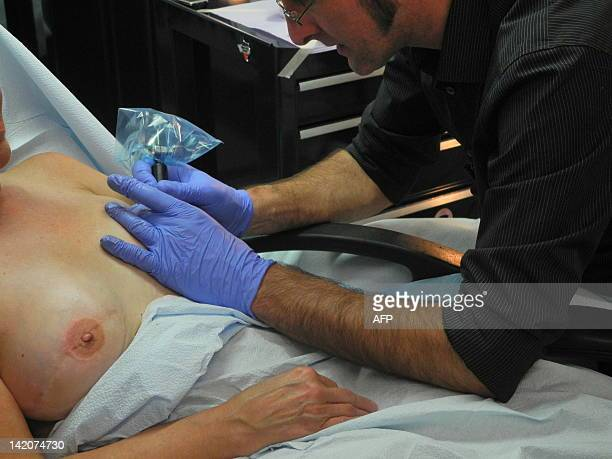TATTOO by Fabienne Faur In his shop in Finksburg Maryland Vincent Vinnie Myers specialises in tattooing nipples and areolas onto women who have...