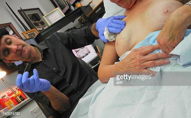 TATTOO by Fabienne Faur In his shop in Finksburg Maryland Vincent 'Vinnie' Myers specialises in tattooing nipples and areolas onto women who have...