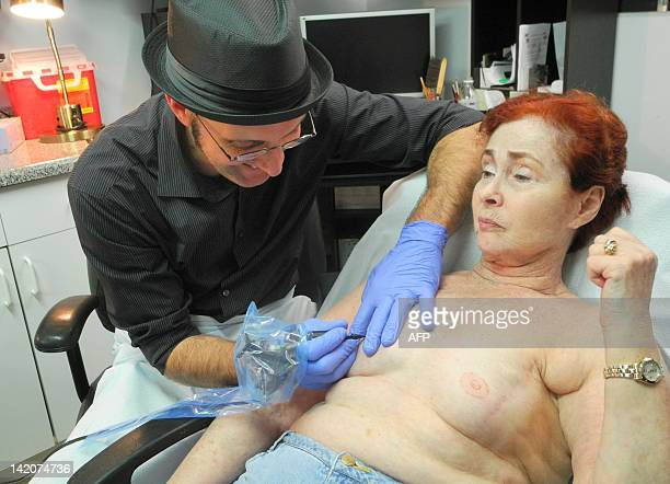 TATTOO by Fabienne Faur In his shop in Finksburg Maryland Vincent Vinnie Myers specialises on Wendy age 72 in tattooing nipples and areolas onto...