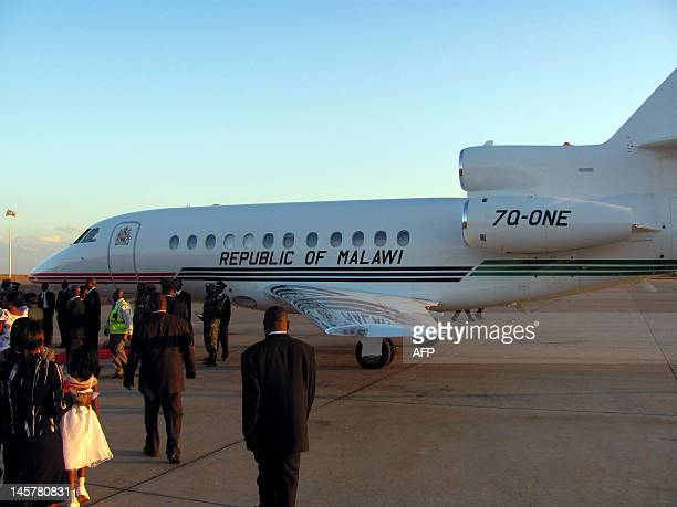 STORY by Felix Mponda A picture taken on May 14 2012 shows Malawi Presidential Jet arriving at Kamuzu International Airport in Lilongwe from...