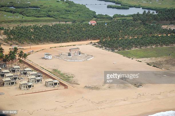 """By Fiacre VIDJINGNINOU- This aerial photo shows a view of """"the Gate of no Return"""" and the dirt road dubbed """"road of sins"""" on October 21, 2009 near..."""