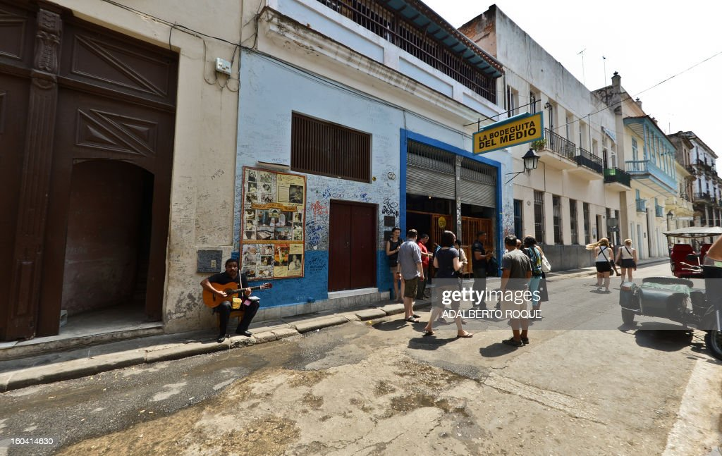 STORY by Francisco Jara Tourists visit the famous Bodeguita del Medio bar in the Cuban capital, Havana, on April 23, 2012
