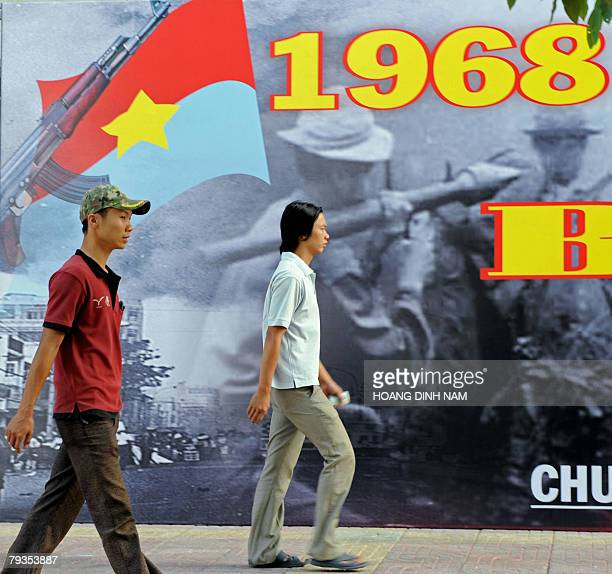 OFFENSIVE by Franck ZELLER People walk past a large poster marking the 40th anniversary of the Vietnam War's Tet 1968 offensive 27 January 2008 in Ho...
