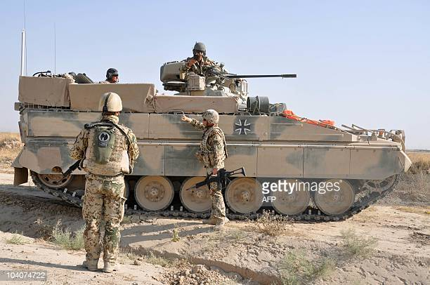 STORY by GREGOR WASCHINSKI German soldiers stand around a 'Marder' armored vehicle on a street near Kunduz during a patrol of the German Armed Forces...
