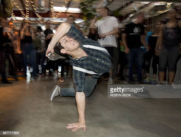 By Guillaume Meyer, Lifestyle-US-dance Mike Rebong dances at the Daybreaker LA morning dance party, at the Springs in downtown Los Angeles Arts...