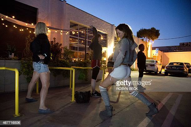 STORY by Guillaume Meyer LifestyleUSdance Women stretch out before the doors open for the Daybreaker LA morning dance party at the Springs in...
