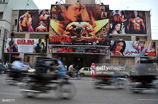 STORY 'ENTERTAINMENTPAKISTANINDIAFILM' by Hasan Mansoor In this photograph taken on January 14 2009 commuters pass a cinema displaying billboads...