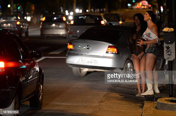 STORY by Javier Tovar A prostitute and a tranvestite wait for clients in the streets of Belo Horizonte Minas Gerais State Brazil on April 25 2013 Sex...