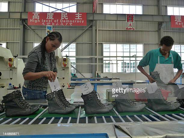 By Jenny Vaughan A picture taken on April 19, 2012 shows people working on the assembly line at Huajian shoe factory in Dukem, Ethiopia. Huajian is...