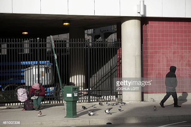 STORY by Joe Szczesny UScityDetroitautodebt A woman sits on a bench at a bus stop January 1 2015 in Detroit Michigan After the largest municipal...