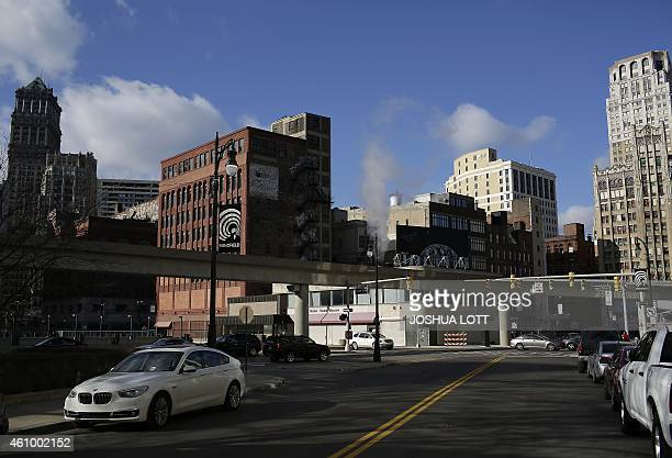 STORY by Joe Szczesny UScityDetroitautodebt Vehicles sit parked along Library Street December 31 2014 in Detroit Michigan After the largest municipal...