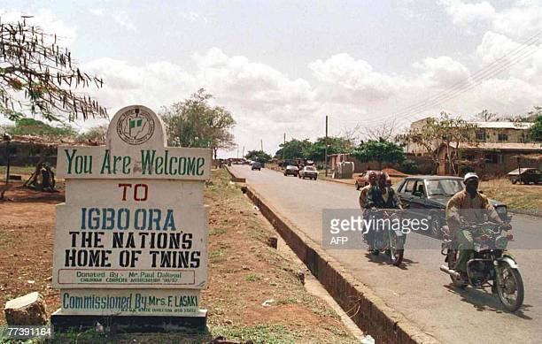 STORY by JOEL OLATUNDE AGOI FILES A signpost welcomes visitors to the southwestern Nigerian town of IgboOra the nation's home of twins 31 March 2001...