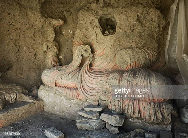 ARCHEOLOGY by Joris Fioriti The remains of a statue of Buddha sit uncovered at an ancient Buddhist site where a religious community set up more than...