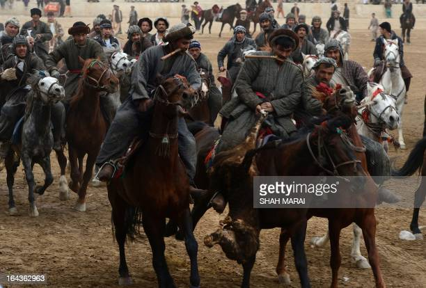 STORY by Joris Fioriti This photo taken on March 22 2013 shows Afghan horsemen competing for a veal carcass during a game of 'buzkashi' in...