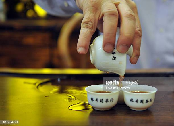 TEA FEATURE by Judith Evans In a picture taken on September 9 2011 tea shop owner Sam Lam prepares a traditional tea according to the Chinese ritual...