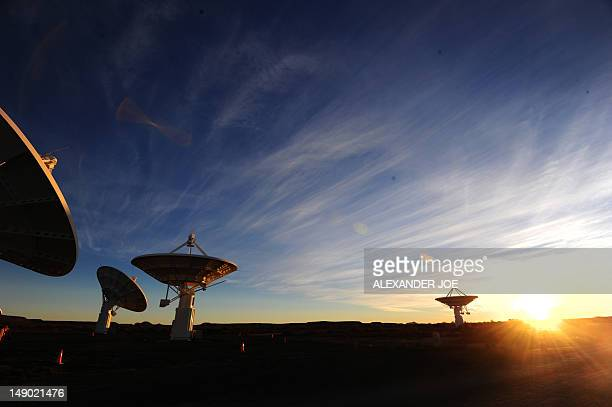 STORY by Justine Gerardy A picture taken on July 4 2012 shows South Africa's Karoobased KAT7 radio telescope array at sunset at The Square Kilometre...