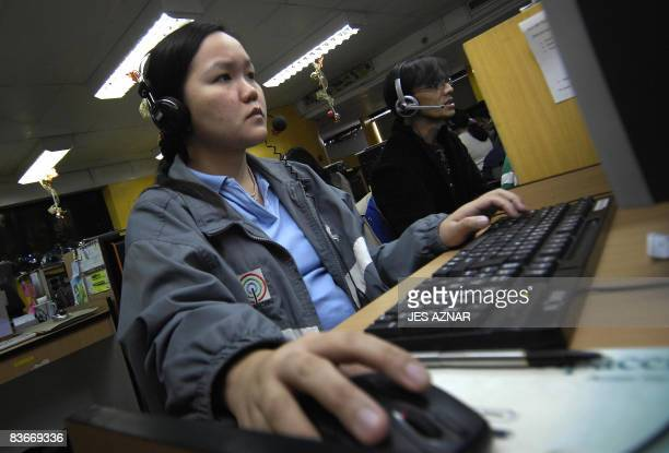 STORY 'FINANCEECONOMYPHILIPPINESINDIAOUTSOURCING' by Karl Wilson An outsourcing representative talks to a client inside a business outsourcing center...