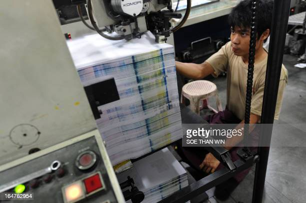 FOCUS by Kelly Mcnamara This picture taken on March 26 2013 shows an employee monitoring the printing of newspapers at a printing house in Yangon...