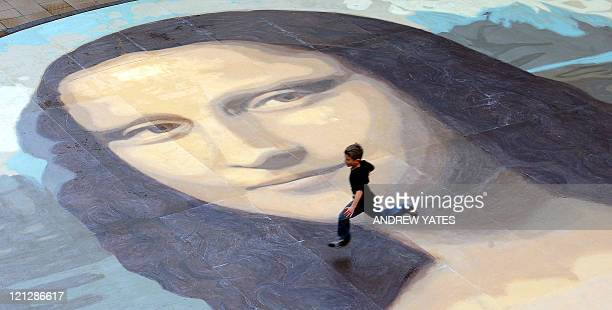 By KERSTIN LOEFFLER - FILES - The said to be world's largest paint by numbers Mona Lisa reproduction is unveiled at the Eagles Meadow shopping centre...