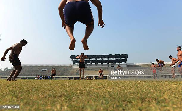 SOCIAL by Khurram SHAHZAD In this photograph taken on November 27 Pakistani kabaddi players warm up at the Punjab Stadium in Lahore Sixteen young...