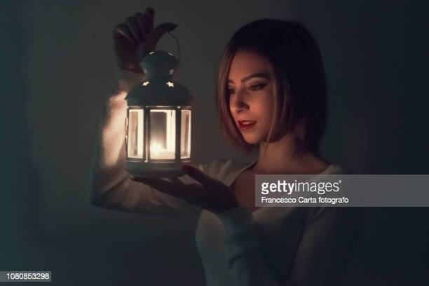 by lantern light - lantern stock pictures, royalty-free photos & images