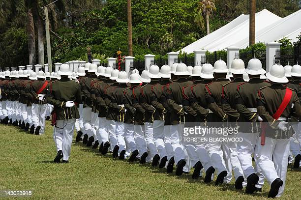 STORY TONGAECONOMYTOURISM by Madeleine Coorey Pith helmet wearing guards parade in front of the Royal Palace in the capital Nuku'alofa March 26 2012...