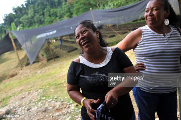 STORY by Marianela Jimenez Marina Lopez a member of the Bribri indigenous group and small producer of cacao laughs while making a visit to the...
