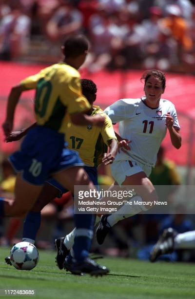 By Meri Simon Julie Foudy keeps her eye on the ball between Brazil's No 17 Pretinha and No 10 Sissi