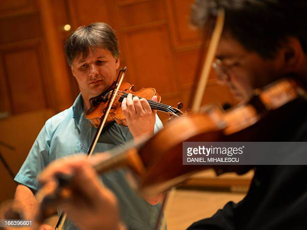STORY by MIHAELA RODINA Picture taken on April 9 2013 shows Liviu Prunaru first violinist of the Concertgebouw Amsterdam playing on a Stradivarius...