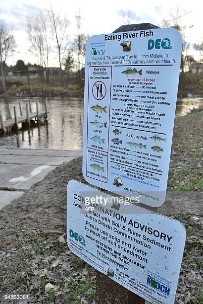 By Mira Oberman, US-environment-pollution-company-Dow Sign warning of dioxin contamination along the Tittabawassee River in Saginaw, Michigan on...