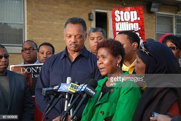 STORY by Mira Oberman USracepoliticscrimejustice Civil rights leader Jesse Jackson stands with Rose Braxton at a September 30 2009 rally on Chicago�s...