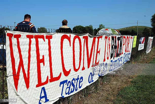 STORY by Mira Oberman USvoteRepublicansRomneycutseconomyBain A banner declaring Welcome to Bainport A Taste of the Romney economy adorns a fence at a...