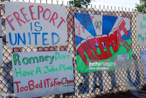 STORY by Mira Oberman USvoteRepublicansRomneycutseconomyBain Protest signs hang on the fence outside a camp set up by Sensata Technologies workers in...