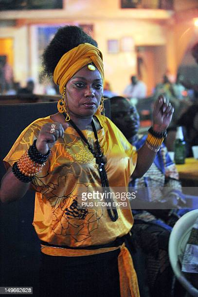 STORY by MJ Smith Yeni Kuti elder daughter of afrobeat musician and activist Fela AnikulakpoKuti dances at the New Afrika Shrine in Lagos on July 29...