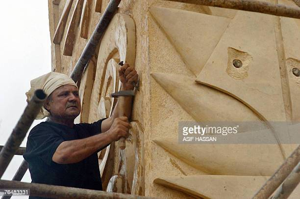 WITH LIFESTYLEPAKISTANCULTUREKARACHI by Mohammed Husain In this picture taken 10 August 2007 Pakistani sculptor Anjum Ayaz works on his 66feet long...
