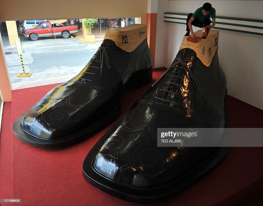 WITH 'LIFESTYLE-PHILIPPINES-FASHION-SHOES' by Mynardo Macaraig A worker  cleans
