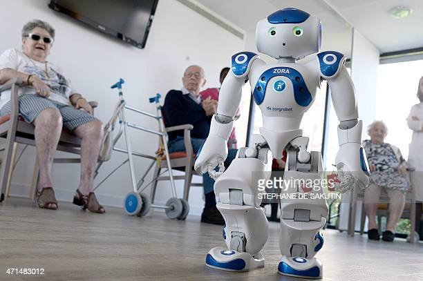 STORY by Nathalie ALONSO Elderly people look at Nao a humanoid robot of the Institute for Intelligent Systems and Robotics at a retirement home on...