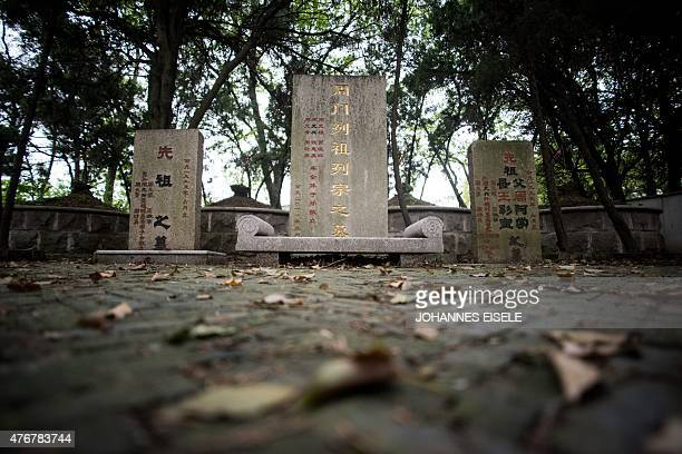 ZHOU by NEIL This picture taken on April 16 shows tombstones of ancestral relatives of China's former security chief Zhou Yongkang who was jailed for...