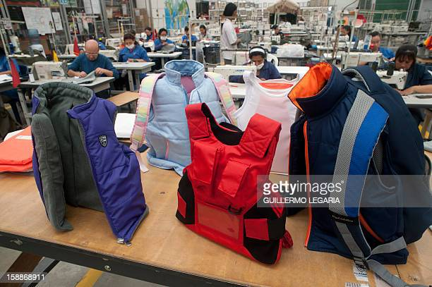 STORY by Nina Negroni Picture of the new clothing line for children with bulletproof protection taken at the factory of Colombian businessman Miguel...