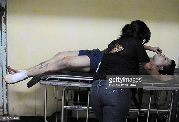 STTORY by Noe Leiva A woman mourns the death of a relative at the morgue in Tegucigalpa on April 28 2013 Central American leaders are expected to...